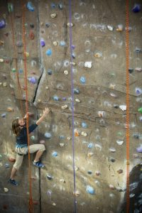 one student rock climbing at Iowa State