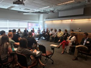 EAC members sit in a paneled discussion with undergraduate students in Hoover