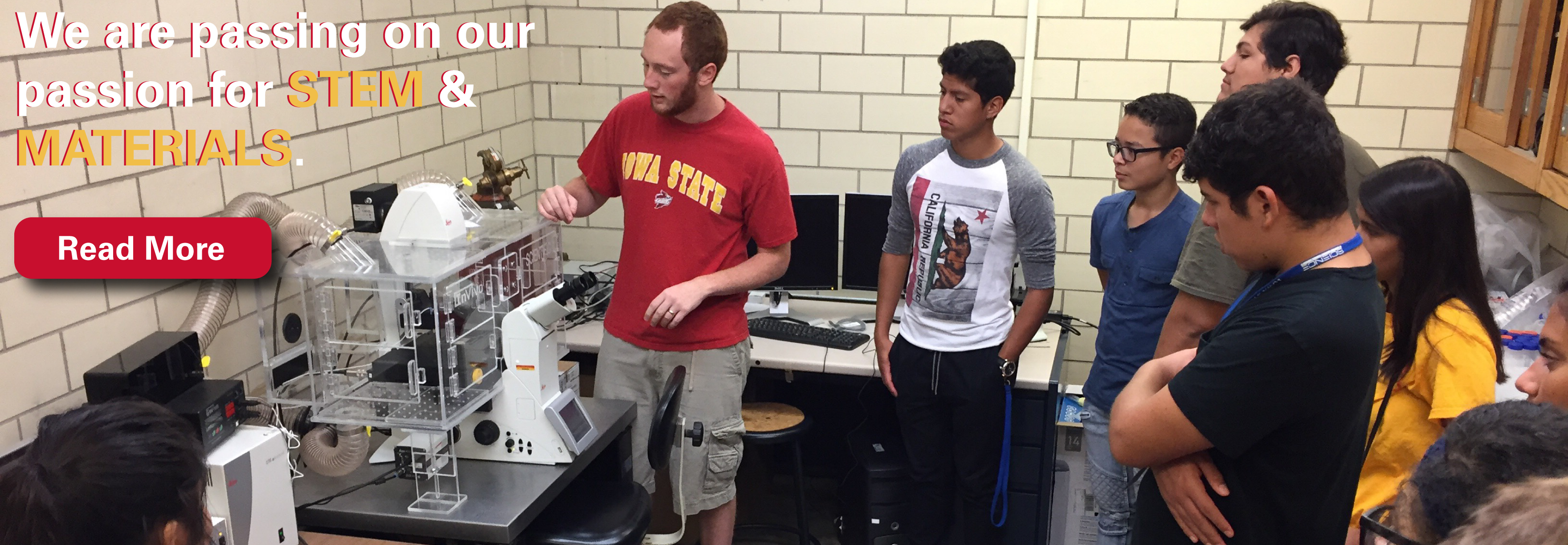Kyle Miller shows students equipment in MSE for an outreach activity.