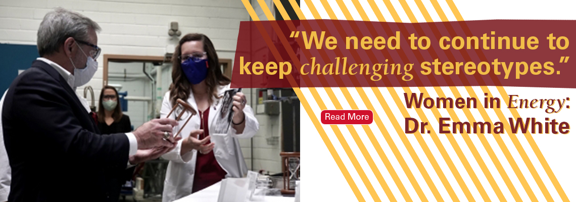 Text reads: We need to continue to keep challenging stereotypes. Women in Energy: Dr. Emma White. Photo shows a woman (Emma) showing a man something inside Ames Lab.